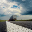 Dramatic sky over asphalt road with car — Stock Photo