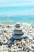 Stack of zen stones near sea — Stock Photo