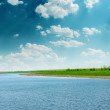 Summer landscape with river and cloudy sky — Stock Photo #21882411
