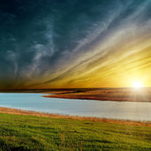 Dramatic sunset over river — Stock Photo