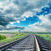 Railroad to horizon under dramatic sky — Stock Photo