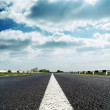 Dramatic sky over asphalt road — Stock Photo #21890317
