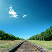 Deep blue sky over old railroad — Stock Photo