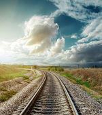 Railway to horizon in sunset — Stockfoto