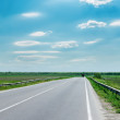 Good cloudy sky and road to horizon — Stock Photo