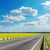 Good landscape with asphalt road under clouds on sky — Stock Photo