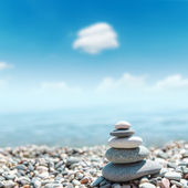 Heap of stones like zen near sea. soft focus — Stock Photo