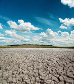 Drought earth and dramatic sky over it — Stock Photo