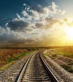 Railroad goes to horizon in sunset — Stockfoto