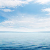 Blue sea and clouds in sky — Stock Photo