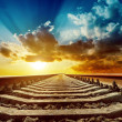 Stock Photo: magic sunset over railroad to horizon