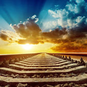 Magic sunset over railroad to horizon — Stock Photo