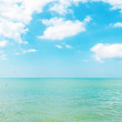 Azure color sea and cloudy sky — Stock Photo