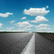 Asphalt road under blue cloudy sky — Stock Photo #33592461