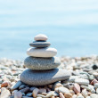 Zen-like heap of stone near sea — Stock Photo