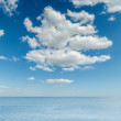 High clouds over sea — Stock Photo