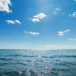 Dark blue sea and deep blue sky with clouds — Stock Photo