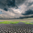 Darken dramatic sky over cracked earth — Stock Photo