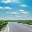 Blue sky and asphalt road — Stock Photo