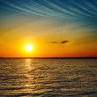Stock Photo: Summer orange sunset over darken sea
