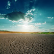 Global warming. dramatic sky over cracked earth — Stock Photo #36269231