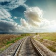 Railroad goes to cloudy horizon — Stock Photo