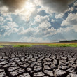 Hot sun over drought earth — Stock Photo