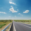 Asphalt road and blue sky — Stock Photo