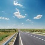 Asphalt road and blue sky — Stock Photo
