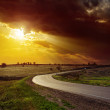 Dramatic orange sunset over road — Stock Photo