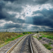 Stock Photo: Railroad goes to dramatic horizon