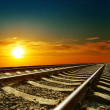 Orange sunset over railroad — Stock Photo