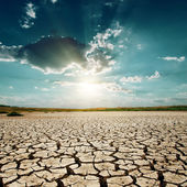 Global warming. sunset over desert — Foto Stock