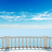 View to sea from terrace with balcony under cloudy sky — Stock Photo