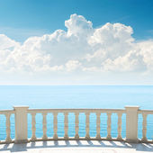 Cloudy sky over sea and balcony — Stock Photo