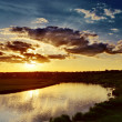 Cloudy sunset over river — Stock Photo #36620319