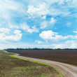 Winding rural road under dramatic sky — Stock Photo