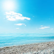 Sun in blue sky over sea — Stock Photo #37167307