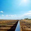 Hot sun in blue sky over old railroad — Stock Photo