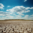 Drought earth under dramatic sky — Stock Photo