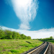 Sky with cloud over railroad in green landscape — Stock Photo