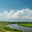 Stock Photo: River under cloudy sky