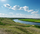 Blue sky with clouds over river — Stock Photo