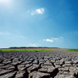Hot sunlight in blue sky over drought earth — Stock Photo #40498319
