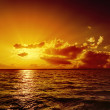 Stockfoto: Orange sunset over water