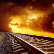 Railroad closeup to orange horizon in sunset — Stock Photo