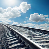 Railroad closeup to horizon in sky with sun — Stock Photo