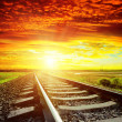 Sunset with red clouds and railroad to horizon — Stock Photo