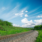 Railroad to horizon and cloudy sky — Stock Photo