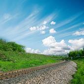 Railroad to horizon and cloudy sky — Stock Photo